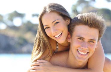 People smiling with veneers